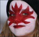 Face Painting of Canadian Flag At Festival